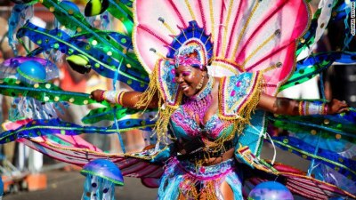 eternallybeautifullyblack:  This carnival queen is representing Grenada. Image and commentary via Black Art Depot.