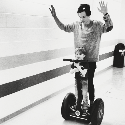 Harry backstage with Lux's cousin Ben