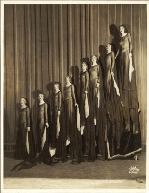 igotsomechildcats:  The White Studio - Artists & Models (8 Ziegfeld Girls on stilts), 1930.