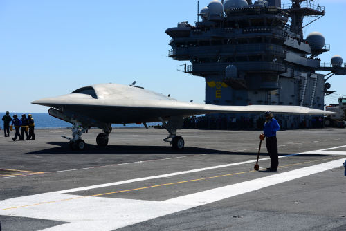 ATLANTIC OCEAN (May 14, 2013) An X-47B Unmanned Combat Air System (UCAS) demonstrator aircraft moves across the flight deck aboard the aircraft carrier USS George H.W. Bush (CVN 77). (U.S. Navy photo by Mass Communication Specialist 3rd Class Kevin J. Steinberg/Released)