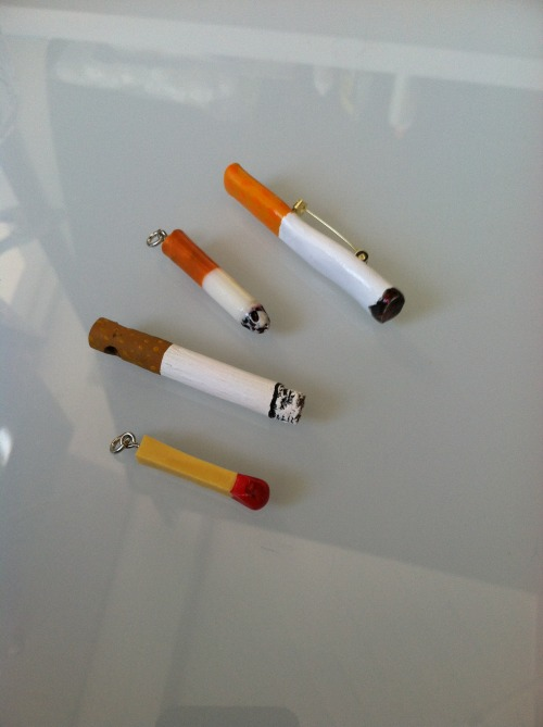 Fake cigg brooch and pendents from Etsy.  PLEASE DON'T SMOKE!!!  I thought these were hilarious so thats why I got them….and I don't smoke, its disgusting, so…please don't do it!