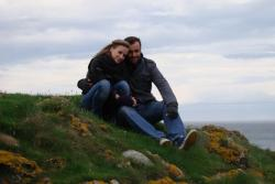 Eyes closed. Posing for a photo just next to a bluff on Todhead Lighthouse. Stonehaven, Scotland.