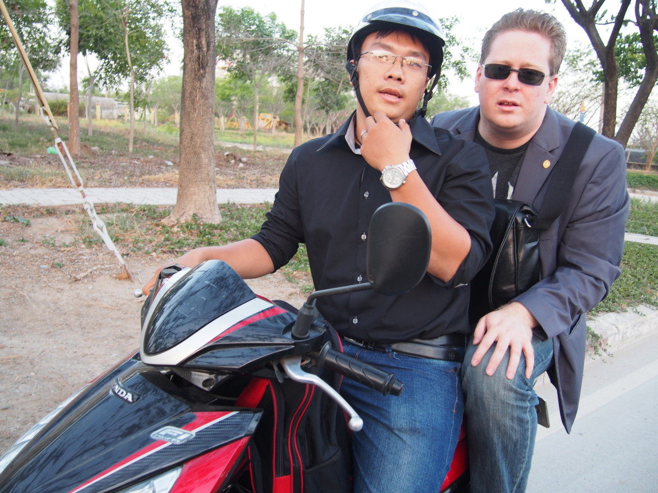 """""""What's the plan, exactly?"""" It's 5:30 in the afternoon and I'm sitting on the curb outside the Saigon port with a magician and a crew of wiry Vietnamese taxi drivers. """"I'm not really sure."""" """"Well, what did they tell you?"""" """"That they'd pick us up here and take us into the city."""" """"But you do this all the time?"""" """"All the time. Most ports we hit. Normally we just go to a bar, show each other different card tricks. Super causal. """" """"And you told them I'm coming?"""" """"I did, but I said you're a magic journalist."""" """"A magic journalist?"""" """"They won't share secrets around a lay person. You need to be part of the community. It'll be fine—just play it cool."""" While I ponder the potential benefits of being a member of the international magic community, a pair of young Vietnamese pulls up on scooters. """"Mr. Jon Armstrong?"""" We each hop onto a bike and ride off, helmetless, into the Saigon sunset. After some gentle probing, I realize my driver, a sweet girl with a perfectly round face who tells me to call her Annie, has no idea who we are and even less of an idea of where we are going. The confusion is compounded moments later when two men on scooters pull up next to us on the road and begin to shake their fists. It seems the local taxi racket doesn't take kindly to strangers swooping into the port and picking up two potenti"""