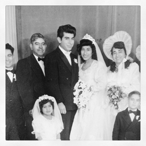 phamista:  Grandma and Grandpa's wedding day. #wedding #blackandwhite #grandparents #family #50s #40s #oldphotos #vintage #love  Reblogging for that giant bow-peep bridesmaid bonnet. Adorably ridiculous! It's always funny to me how much wedding fashion has evolved. From that to stuff like this… I think somewhere in the middle is a happy medium :)