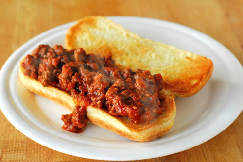 Crock Pot Sloppy Joes Ingredients (serves 4-6)1 lb ground beef1/4 cup finely minced onion1 tsp minced garlic1 15 oz can of tomato sauce1/4 cup water1 tbsp red wine vinegar1 tbsp worcestershire sauce1/2 tsp salt1/4 tsp black pepper1 tbsp chili powder1 tsp red pepper flakes2 tsp yellow mustardHot dog or hamburger bunsButterDirections1. Brown the ground beef in a large skillet. Drain off most of the fat. Add the onions and garlic and cook until onions are translucent, about 2-3 minutes.2. In the crock pot, combine all remaining ingredients except buns and butter. Add the ground beef mixture and stir to combine. Cook on low for 6-8 hours.3. When beef is ready to serve, butter buns. Broil until tops are golden brown, about 1 minute.4. Spoon the ground beef onto the buns and serve. Enjoy!
