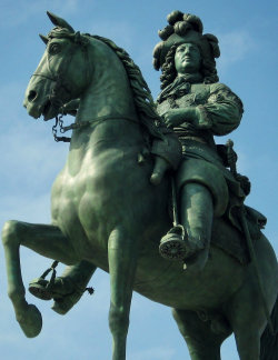 The equestrian statue of Louis XIV, designed by Pierre Cartellier, the rider by Louis Petitot, bronze by Charles Crozatier in 1838. Chateau Versailles, France. Photo by Amber Maitrejean