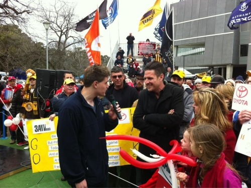 Me being interviewed on the radio on AFL Grand Final day. I had to look one of my all-time heroes Leigh Matthews in the eye and tell him I hoped that the Swans would beat the Hawks.