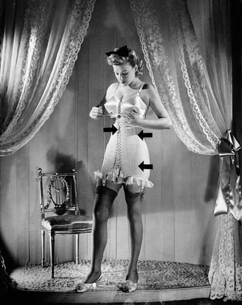 "vintagegal:   Model showing how to lace a corset w. arrows pointing at spots where laces begin & end now that elastic & zippers have ""gone to war"" as the WPB's (War Production Board) jettisoning of amenities is put to consumers. 1942 (x)"