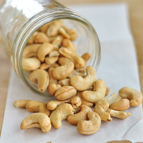 "nutritionasmedicine:     7 HEALTH BENEFITS OF CASHEWS The cashew tree is native to Brazil, where its fruit is considered a delicacy. In the 16th century, the Portuguese introduced them to India and some African countries, where they are now also grown. What we call the cashew nut is actually the seed of this fruit. Cashews are rich in iron, phosphorus, selenium, magnesium and zinc. They are also good sources of phytochemicals, antioxidants, and protein. Cancer Prevention - Cashews are ripe with proanthocyanidins, a class of flavanols that actually starve tumors and stop cancer cells from dividing. Studies have also shown that cashews can reduce your colon cancer risk. Their high copper content also endows the seed with the power to eliminate free radicals and they are also good sources of phytochemicals and antioxidants that protect us from heart disease and cancer. Heart Health - Cashews have a lower fat content than most other nuts and most of it is in the form of oleic acid, the same heart-healthy monounsaturated fat found in olive oil. Studies show that oleic acid promotes good cardiovascular health by helping to reduce triglyceride levels, high levels of which are associated with an increased risk for heart disease. Cashews are wonderfully cholesterol free and their high antioxidant content helps lower risk of cardiovascular and coronary heart diseases. The magnesium in cashews helps lower blood pressure and helps prevent heart attacks. Hair and Skin Health - Cashews are rich in the mineral copper. An essential component of many enzymes, copper plays its part in a broad array of processes. One copper-containing enzyme, tyrosinase, converts tyrosine to melanin, which is the pigment that gives hair and skin its color. Without the copper cashews are so abundant in, these enzymes would not be able to do their jobs. Bone Health - Cashews are particularly rich in magnesium. It's a well-known fact that calcium is necessary for strong bones, but magnesium is as well. Most of the magnesium in the human body is in our bones. Some of it helps lend bones their physical structure, and the remainder is located on the surface of the bone where it is stored for the body to use as it needs. Copper found in cashews is vital for the function of enzymes involved in combining collagen and elastin, providing substance and flexibility in bones and joints. Good for the Nerves - By preventing calcium from rushing into nerve cells and activating them, magnesium keeps our nerves relaxed and thereby our blood vessels and muscles too. Too little magnesium means too much calcium can gain entrance to the nerve cell, causing it to send too many messages, and leading to too much contraction. Insufficient magnesium leads to higher blood pressure, muscle tension, migraine headaches, soreness and fatigue. Not surprisingly, studies have demonstrated that magnesium helps diminish the frequency of migraine attacks, lowers blood pressure and helps prevent heart attacks. Prevent Gallstones - Data collected on 80,718 women from the Nurses' Health Study demonstrates that women who eat at least an ounce of nuts each week, such as cashews, have a 25% lower risk of developing gallstones. Weight Loss - People who eat nuts twice a week are much less likely to gain weight than those who rarely eat nuts. Cashew nuts are indeed relatively high in fat, but it is considered ""good fat."" This is attributable to the ideal fat ratio in the nut, 1:2:1 for saturated, monounsaturated, and polyunsaturated, respectively, which is recommended by scientists for tip-top health. Cashew nuts contain less fat than most other popular nuts, including peanuts, pecans, almonds and walnuts. They are dense in energy and high in dietary fiber, making them a very valuable snack for managing weight gain. Cashew Nut Info Found HERE"
