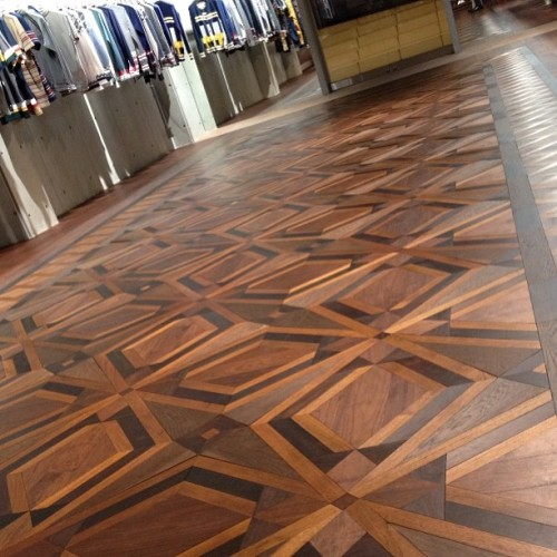 This awesome wood floor at White Mountain Engineering store is meant to look like a rug pattern. Wow. JM