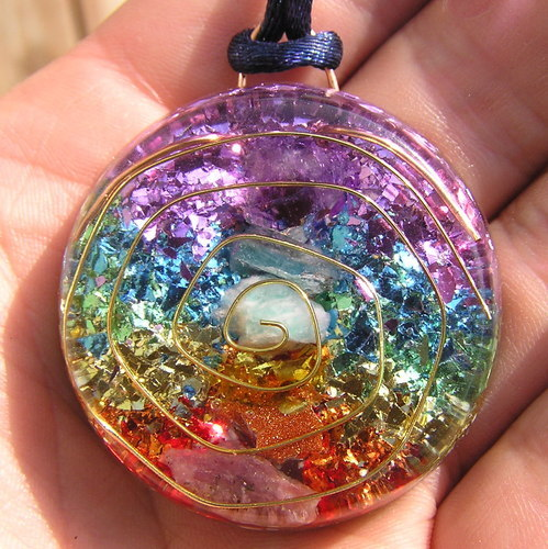 mentalalchemy:  mentalalchemy:  This 7 Chakras Orgone Energy Pendant includes rough ruby for the base chakra, goldstone for the navel chakra, amber for the solar plexus, amazonite for the heart chakra, apatite for the throat chakra, amethyst for the third eye and quartz crystals throughout the pendant for the crown chakra.  Activates and boosts the chakras to work in balance and greater power. The navy blue nylon cord comes with the pendant. This pendant is about 1 and 1/2 inches across and about 1/2 inch thick. You can see the main stones in the middle of the pendant. The colors around it are sparkle flakes. It includes the cord, so it is ready to wear.  Encased in the polyester resin. Under the pressure of the resin the quartz sends out its subtle piezoelectric pulse which the metals in a way are a conductor for it. Any dense/negative energy that comes near this pendant is transmuted into positive, expansive orgone energy space.$35 via Paypal or Visa/Debit cardMessage me if interested.I have multiples of these but they're going fast, so if you want it, let me know ASAP!  Posting once more before bed. Message me if interested and ill ship them out tomorrow when I wake up :)
