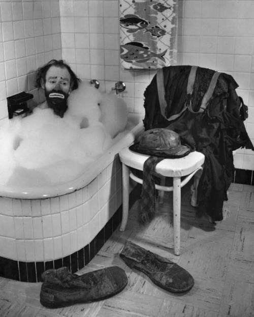 indypendent-thinking:  Ringling Circus clown Emmett Kelly in a bubble bath, 1955  {Photo taken as a favor to Kelly, who wanted the image for his Christmas card. The photographer, Joseph Janney Steinmetz's  wife, Lois Foley Steinmetz, was crouched down out of sight behind the chair that held Kelly's clothing, with an egg beater in her hand. After every shot Joe took, Lois would leap out of hiding, use the egg beater to increase the foam in the tub, and conceal herself once again.} (via Florida Memory )