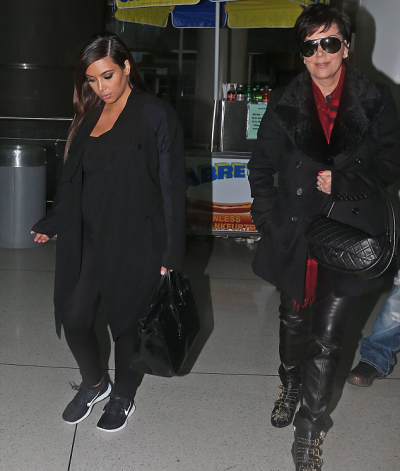 Kim and Kris catching a flight out of JFK  Airport on Monday.