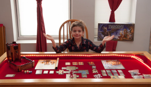 seenontabletop:  My 8 y.o. doing his best Wil as we prepare to start our Descent (2nd ed.) campaign.  We have it set up on our DIY game table that is built in underneath the dining surface (best. wife. ever.). Also pictured is our homemade dice tower.  My wife calls me a Martha Stewart of geek.   Playing games has become a big part of our family and social life, and I love seeing it celebrated here!