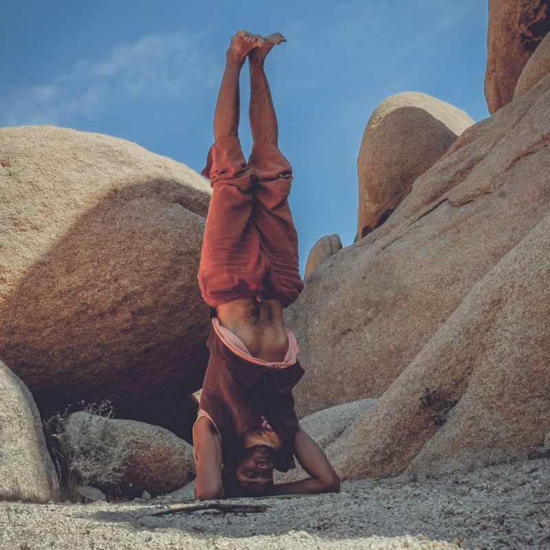 the-art-of-yoga:  Sirsasana (Headstand Pose) Sirshasana is a very powerful asana which activates and awakens the Sahasrara (Crown) Chakra.   For this reason it is considered one of the greatest asanas.  Rooting the crown of the head to the ground deepening ones pranic connection with the Earth.  This reversal of gravity aids in tissue regeneration and deeper exhalations removing greater amounts of carbon dioxide from the lungs. Location: Joshua Tree, California Yogi: Casino
