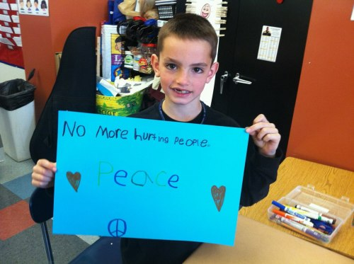 "inothernews:  An undated classroom photo of Martin Richard, the youngest victim in the Boston Marathon bombings, shows him holding up a handwritten sign that reads ""No more hurting people.  Peace.""  The photo was posted to Facebook by a friend of Martin's teacher.  He did not survive; his mother and sister were injured in the blasts.  (Via Twitter.com/jaketapper)"