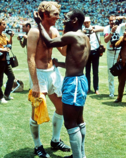 Pele and British captain Bobby Moore trade jerseys as a symbol of respect, at the 1970 World Cup that was tainted by racism.