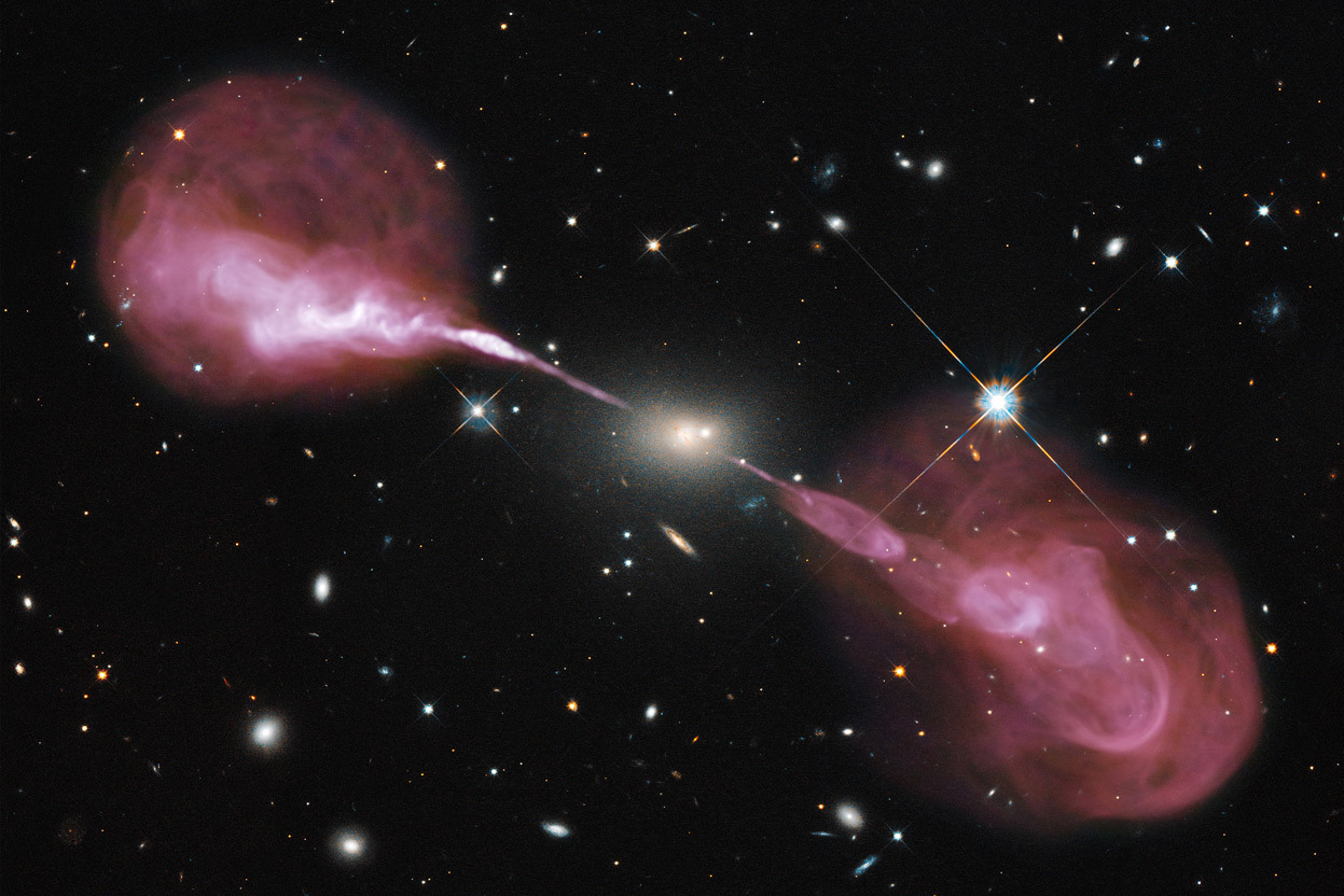 Day 10 of the 2012 Hubble Space Telescope Advent Calendar, one of 25 photos (eventually).  A Multi-Wavelength View of Radio Galaxy Hercules A. Spectacular jets powered by the gravitational energy of a supermassive black hole in the core of the elliptical galaxy Hercules A illustrate the combined imaging power of two of astronomy's cutting-edge tools, the Hubble Space Telescope's Wide Field Camera 3, and the recently upgraded Karl G. Jansky Very Large Array (VLA) radio telescope in New Mexico. Some two billion light-years away, the yellowish elliptical galaxy in the center of the image appears quite ordinary as seen by Hubble in visible wavelengths of light. The galaxy is roughly 1,000 times more massive than the Milky Way and harbors a 2.5-billion-solar-mass central black hole that is 1,000 times more massive than the black hole in the Milky Way. But the innocuous-looking galaxy, also known as 3C 348, has long been known as the brightest radio-emitting object in the constellation Hercules. Emitting nearly a billion times more power in radio wavelengths than our Sun, the galaxy is one of the brightest extragalactic radio sources in the entire sky. The VLA radio data reveal enormous, optically invisible jets that, at one-and-a-half million light-years wide, dwarf the visible galaxy from which they emerge. The jets are very-high-energy plasma beams, subatomic particles and magnetic fields shot at nearly the speed of light from the vicinity of the black hole. The outer portions of both jets show unusual ring-like structures suggesting a history of multiple outbursts from the supermassive black hole at the center of the galaxy. The innermost parts of the jets are not visible because of the extreme velocity of the material, which causes relativistic effects that beam the light away from us. Far from the galaxy, the jets become unstable and break up into the rings and wisps. (NASA, ESA, S. Baum and C. O'Dea (RIT), R. Perley and W. Cotton (NRAO/AUI/NSF), and the Hubble Heritage Team, STScI/AURA)