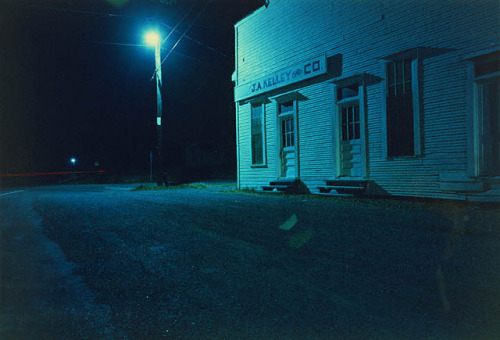 J.A. Kelley & Co. at Night (c. 1970) by William Eggleston