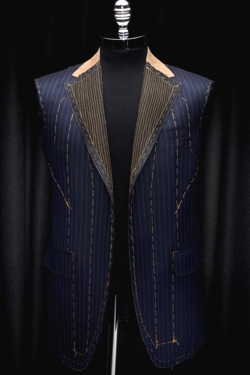 jhilla:  Oxxford Construction. Very fine, hand padded lapels.