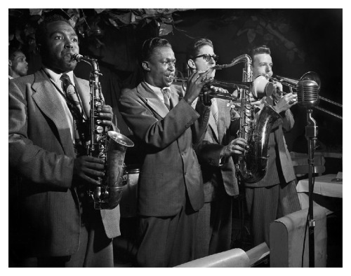 Today's cool Miles Davis photo is a 1948 shot featuring Miles alongside Charlie Parker, Allen Eager, and Kai Winding. Parker only looks a little bit high.  Don't forget to check out GOING MILES! (http://www.alangoldsher.com/Going_Miles/Going_Miles.html)