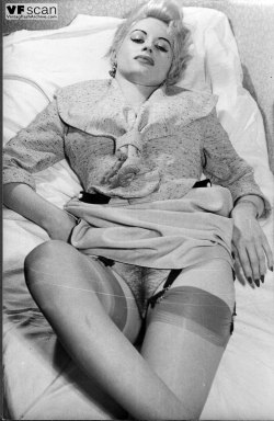 Glamourous blonde from the 60's shows off her hairy cunt,