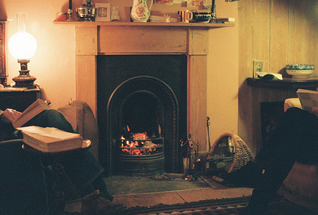 unterihremkissen:  Reading Beside the Fire by tomspearing on Flickr.