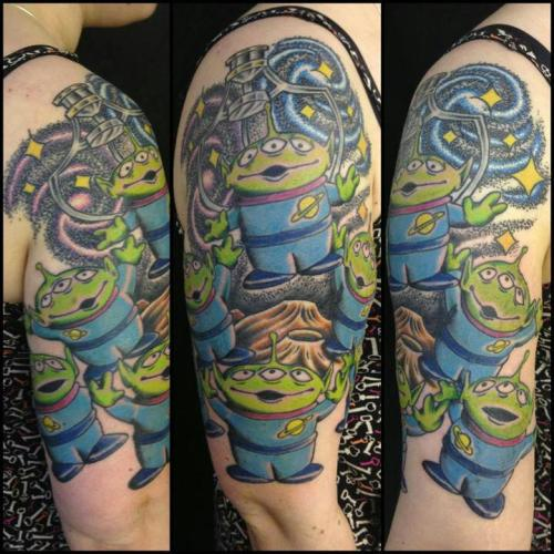 fuckyeahtattoos:  My Toy Story alien half sleeve.By Daniel Morris @ Rain City, Manchester, UK.