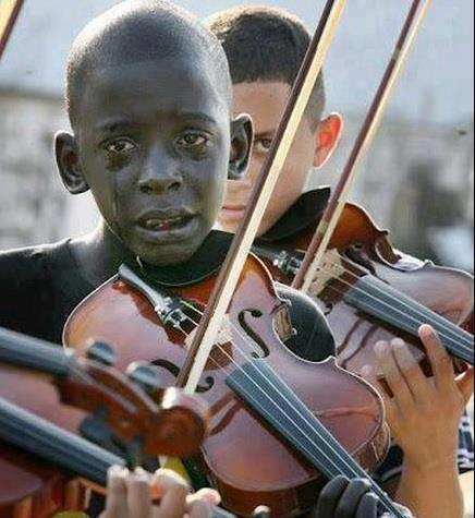 "caption: Boy mourns the death of his violin teacher as he plays at his teacher's funeral. He had helped this boy escape poverty and violence by taking him and similar boys under his wing.  2013 started out as a year of mourning for me.. And so many people around me experienced similar losses throughout the year. And as I recently have reflected these past few days in light of recent tragic events, I cannot mask the sorrow that comes from a loved one's departure…  That emptiness from parting goodbye leaves a lingering wound that bores at your heart and soul. But even in this pain, I think God has been reminding us that ""Precious in the sight of the Lord is the passing of his Saints"" -Psalm 116:15.  Prayers out to all. Prayers out to you."