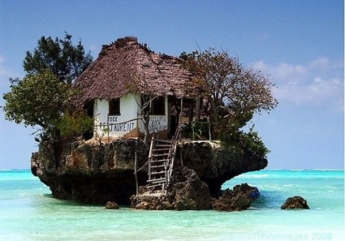 lovelychikaloca:  Restaurant on a cliff on the east coast of Zanzibar,Tanzania. Depending on the tide the restaurant can be reached both on foot and by boat.
