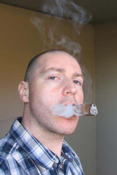 Sometimes a cigar is just a cigar and sometimes it looks like that guy is practicing blowing me