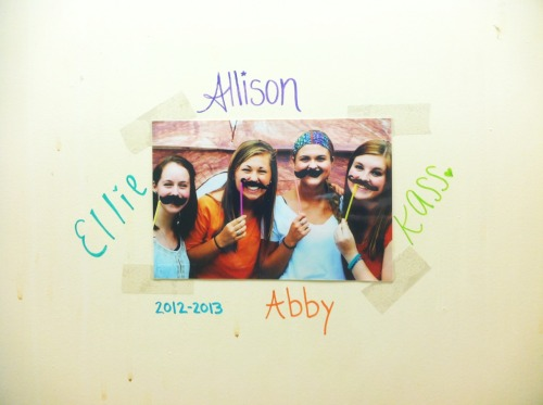 Leaving our mark behind the mirror in our dorm room. Its been a good year!
