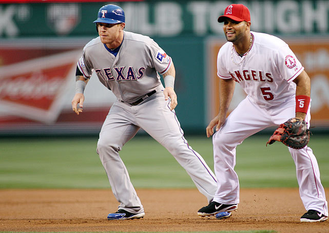 Josh Hamilton and Albert Pujols are teaming up in Anaheim. The Angels signed the former Rangers outfielder to a 5-year, $125 million deal, making him the latest of baseball's $100 million men. (Rob Leiter/Getty Images) ROSENBERG: How Hamilton ended up on the AngelsGALLERY: Rare Photos of Josh Hamilton | Albert Pujols