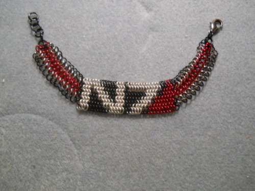 graycrowdesigns:  I'm Commander Shepard and this is my favorite bracelet on the Citadel. $40 plus shipping, available here: http://www.etsy.com/listing/151774360/mass-effect-chainmail-bracelet-n7