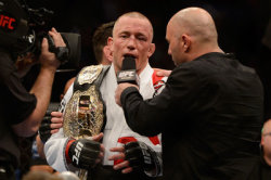 ufcmmapictures:  Trainer stamps expiration date on Georges St. Pierre's fighting future Download this picture - http://bit.ly/VL6e2T
