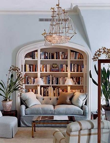 Powder blue living with a nook bookcase and ship chandelier