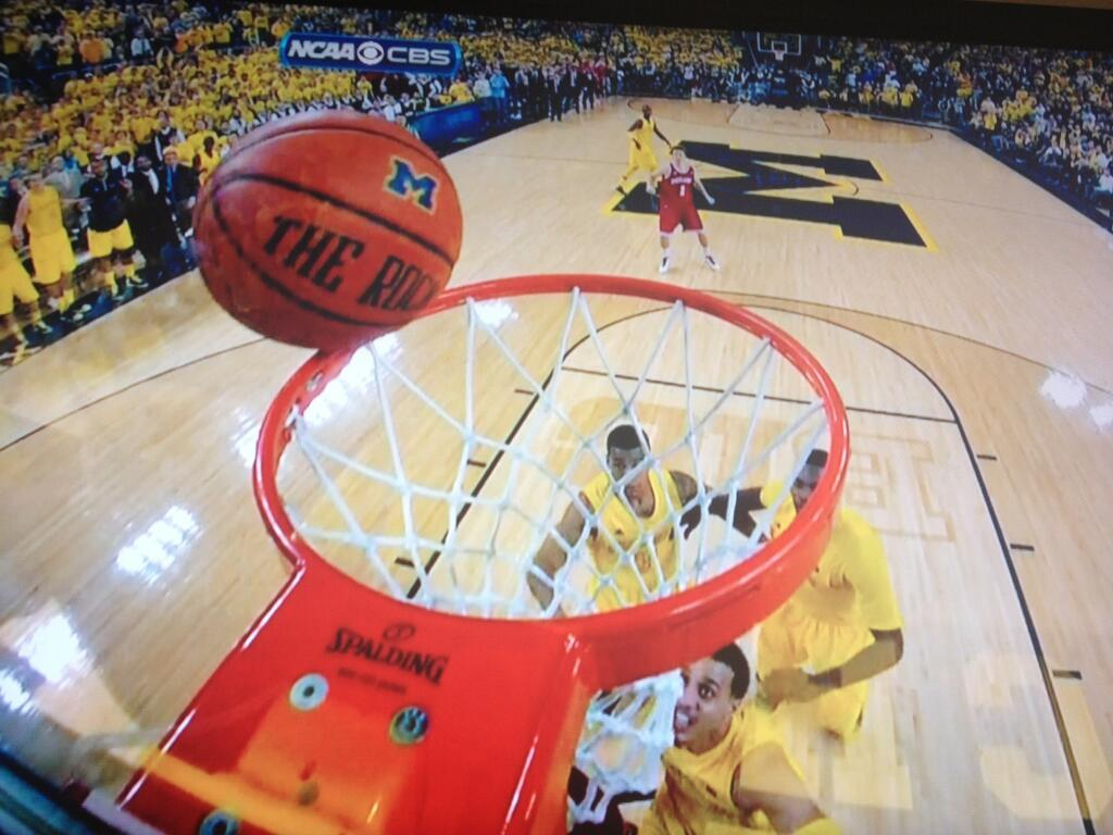cbssports:  How close was Michigan's final shot? It stayed on the rim for ages and missed by inches!  Yeah, that was nuts.