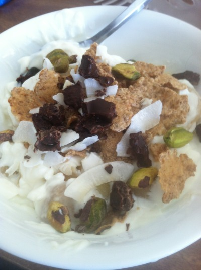 my breakfast- banana, greek yogurt, raw pistachios, coconut flakes, bran flakes, and some chocolate chunks with coffee nibs!