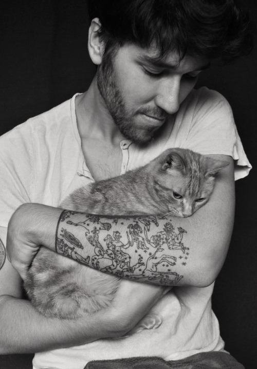 I think that cat is lost in his constellation tattoo.