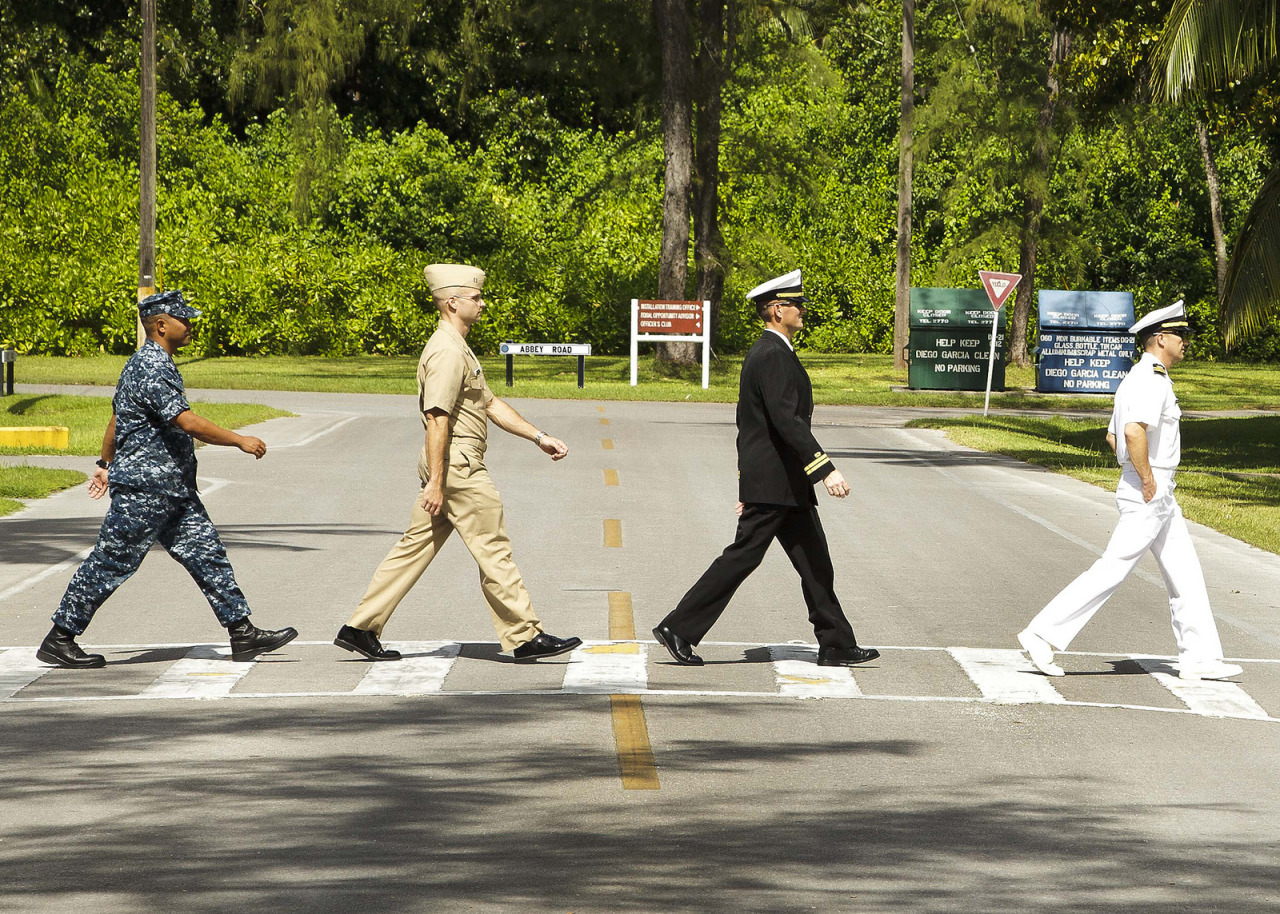 Abbey Road Revisited by NAVFAC on Flickr. Abbey Road Revisited Via Flickr: U.S. Navy Civil Engineer Corps officers at Public Works Department Diego Garcia recently re-created the famous Beatles 'Abbey Road' album cover at a road on the island with the same name. Wearing the different Navy uniforms from left to right are: Cmdr. Victor Velasco, Lt. Corey Tomala, Lt. Michael McManus and Lt. Cmdr. Michael Chucran. (U.S. Navy photo by Randy Belz, DG21)