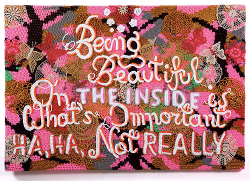 Hahaha, not really. booooooom:  Crocheted text works by Olek.