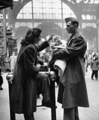 back-in-the-old-day:  A soldier says goodbye to his wife and infant child in Pennsylvania Station before shipping put for service in World War II, New York, New York, 1943.