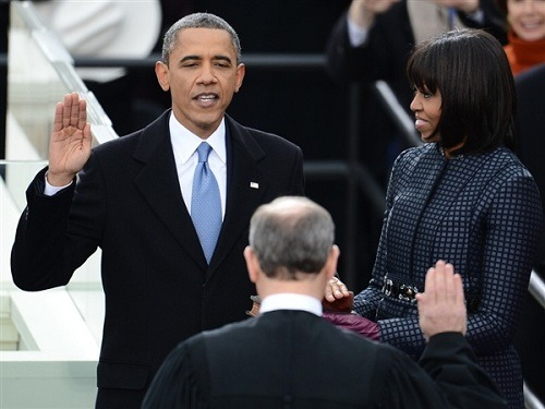 "breakingnews:  Obama calls for equality for women, gays in inaugural address In his second inaugural address, U.S. President Barack Obama urged the nation to make sure that women were paid equally to men and that gay men and lesbians were treated equally under the law.""Our journey is not complete until our gay brothers and sisters are treated like anyone else under the law — for if we are truly created equal, then surely the love we commit to one another must be equal as well,"" he said.Obama also vowed to respond to the threat of climate change, to maintain economic vitality, to protect the poor and to defend the country's people through ""strength of arms and rule of law."" Read more from The New York Times. Read the full text of Obama's inaugural speech from NBC News. More on today's inaugural events on BreakingNews.com.Photo: President Barack Obama takes the oath of office during the 57th Presidential Inauguration ceremonial swearing-in at the Capitol on Jan. 21, 2013, in Washington, D.C. (Emmanuel Dunand / AFP - Getty Images)"