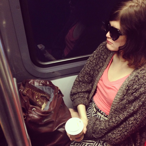 Hearts and coffee on the T. #muni #passengers #sunglasses #transit #window #reflection