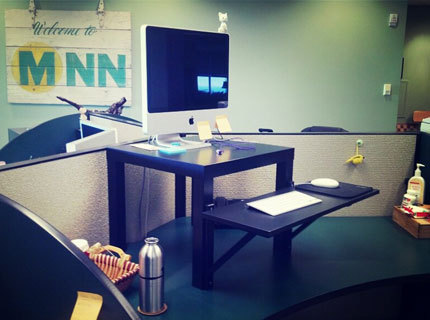 MNN photo editor Catie Leary kicked off 2013 by transforming her cubicle into a standing desk. Research shows that people could live longer if they cut down the amount of time they spend sitting, so it's definitely a step in the right direction and we suspect it's only a matter of time until other MNN employees stand up and join the standing-desk bandwagon. Although Catie says her new desk is taking some getting used to, she says she won't go back to sitting eight hours a day. (Plus, the rest of us enjoy waving at her from down below.) Want to create your own DIY standing desk? Here's how Catie made hers with just $22 of IKEA parts. Keep up with what's happening at MNN by following our Editors' Blog!