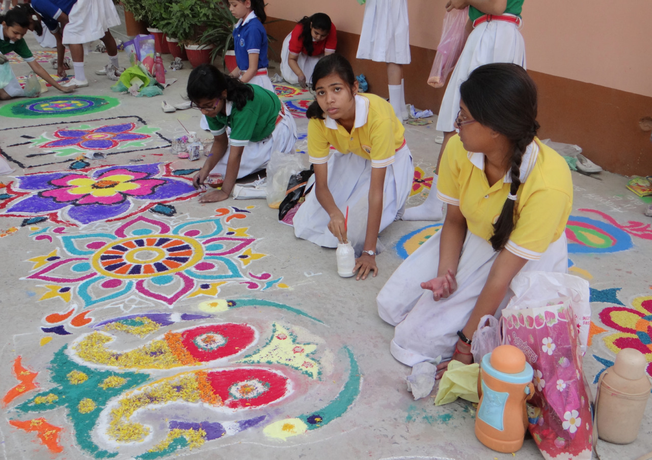 Rangoli Competition Around 150 students from class six to 10 took part in the Rangoli competition at Nazareth Academy, Gaya, on May 4. Their colorful production filled the auditorium, stage, open lobby, and the spacious concrete grounds in front of the convent and the administration block of the school. The audiences were spell bound as they went around admiring the blooming talents of the young artists. Various competitions are held throughout the year to develop the unique talents of each child.