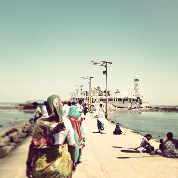 The walk to Haji Ali Dargah, a mosque off the coast of Mumbai. At high tide, the causeway floods, turning it into an island. #latergram (at Haji Ali)