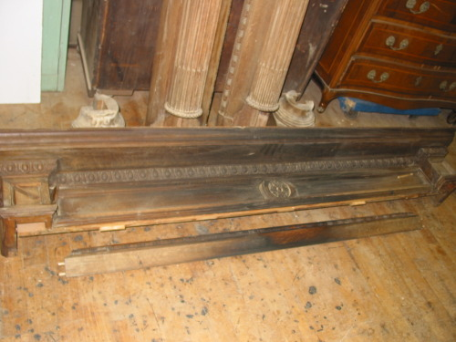 19th century white oak fireplace surround and mantle in need of extensive cleaning and soot removal.  Many pieces of missing molding will be fabricated to match existing wood grain, color and finish. Small sample of experimental cleaning on piece below the mantle.