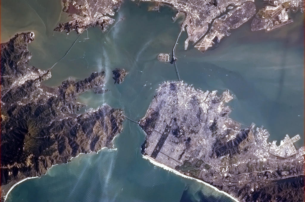 colchrishadfield:  The Golden Gate Bridge from space, and if you look closely, its shadow.  Gonna bike ride over this bridge today!