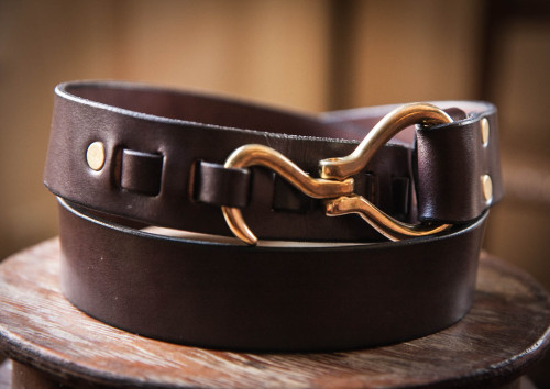 "A Great Value in Custom Belts: Narragansett Leathers Narragansett Leathers makes some of my favorite belts. The one pictured above is a fairly recent purchase, and is their 1 3/8"" Hoof Pick Belt. It costs $47 (one of Narragansett's pricier offerings), and is made from top-grade American-tanned bridle leather. While $47 isn't the cheapest price on a belt that you can find, it is certainly, in my opinion, one of the soundest investments you can make on a belt that I've ever come across—especially when you consider the fact that each belt is custom made to order. The belt I've worn nearly every day for the past two years is Narragansett's 1"" belt in Chestnut leather with an oval brass buckle. The leather has aged beautifully and shows no sign of giving up the ghost any decade soon, and it only cost $34. I've got my eyes set on one of their Pelikan Hook Belts for purchase some time in the near future. The ordering process is relatively simple, and quite quaint in today's age of impersonal ecommerce. It involves easy instructions for measuring a belt that you currently wear, which you then email to Alan McKinnon (who co-owns the business with his partner Ann Marie) along with what belt model, leather width, and buckle style you want. Alan will then respond with PayPal instructions, and once you've made your payment he makes your belt, which will arrive on your doorstep in a matter of weeks.  I highly recommend getting yourself a Narragansett Leathers belt. They're beautifully crafted, built to last, and priced honestly."
